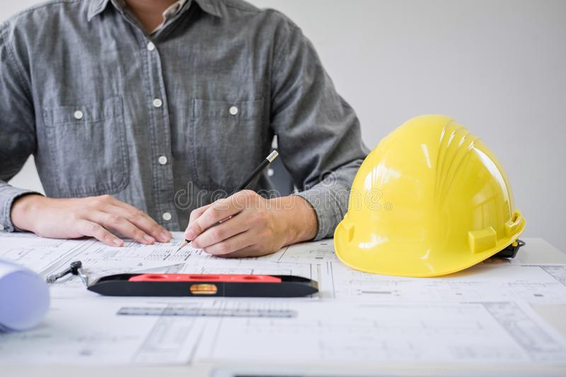 Construction engineering or architect hands working on blueprint inspection in workplace, while checking information drawing and. Sketching for architecture stock photography