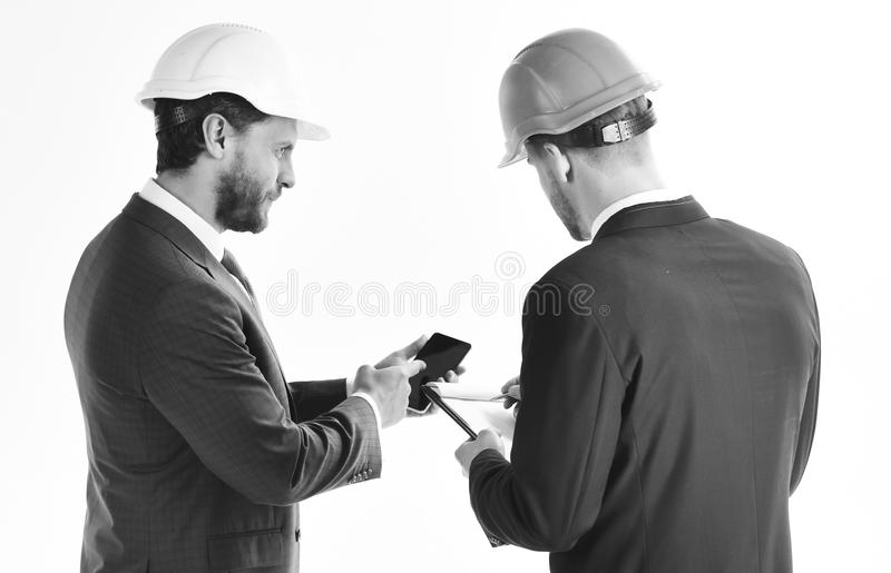 Construction, engineering, confidence, architecture, partnership concept. Business partners look at building plan. royalty free stock photography