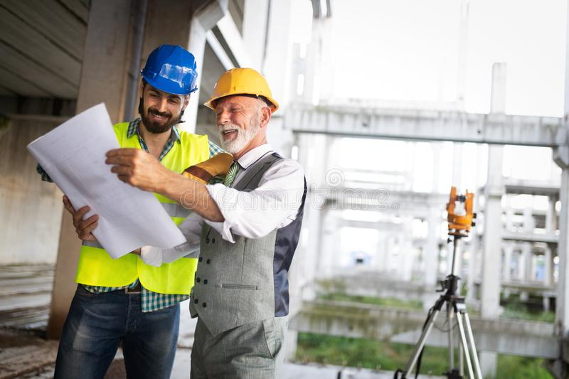 Construction engineers discussion with architects at construction or building site stock photography