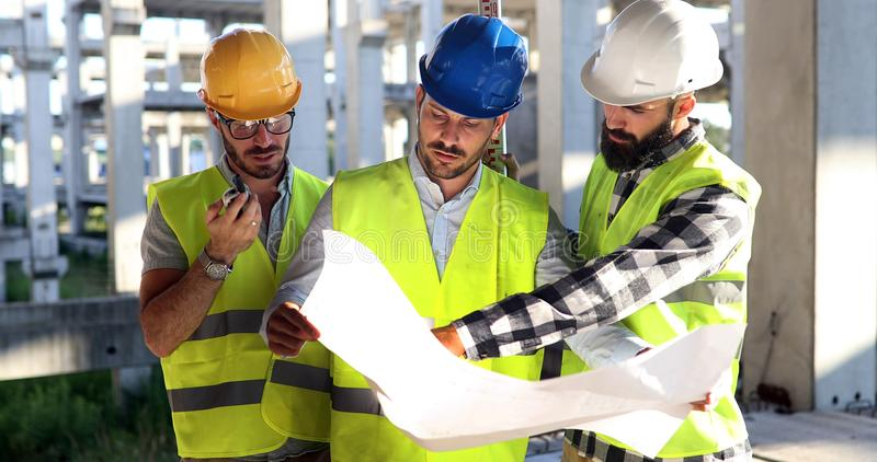 Construction engineers discussion with architects at construction site. Or building site stock images