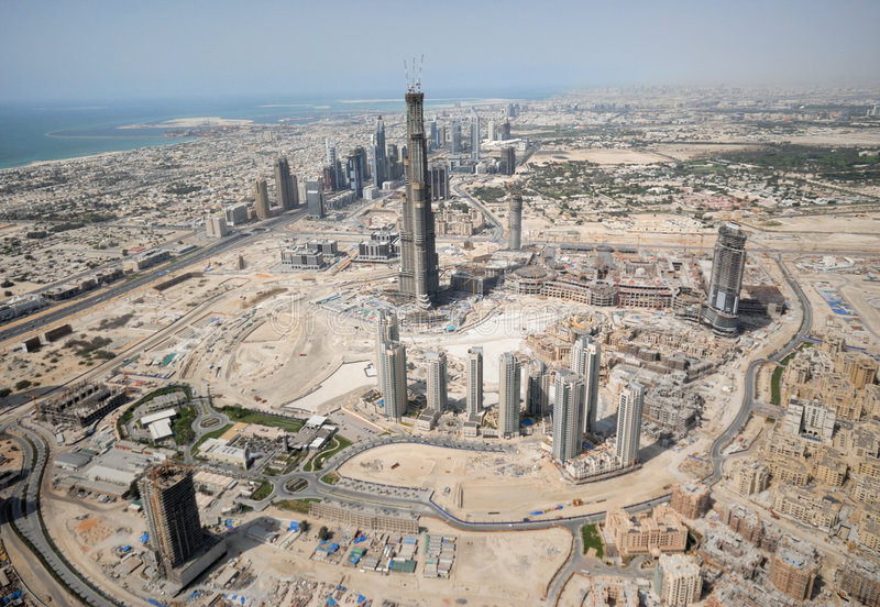 Construction Of An Entire City. Construction & Property Development On A Massive Scale In The Middle East. The Tall Building Seen Here Is Burj Dubai Located In stock images