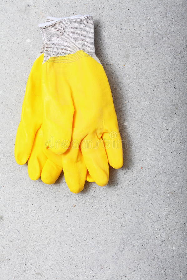 Free Construction Equipment Yellow Work Protective Gloves Royalty Free Stock Photos - 33900108