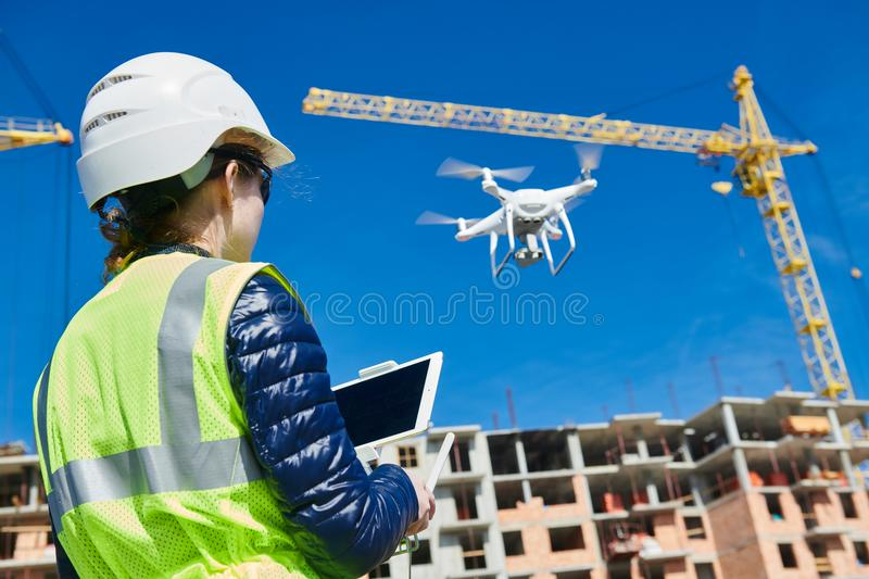 Drone inspection. Operator inspecting construction building site flying with drone. Construction female worker piloting drone at building site. video