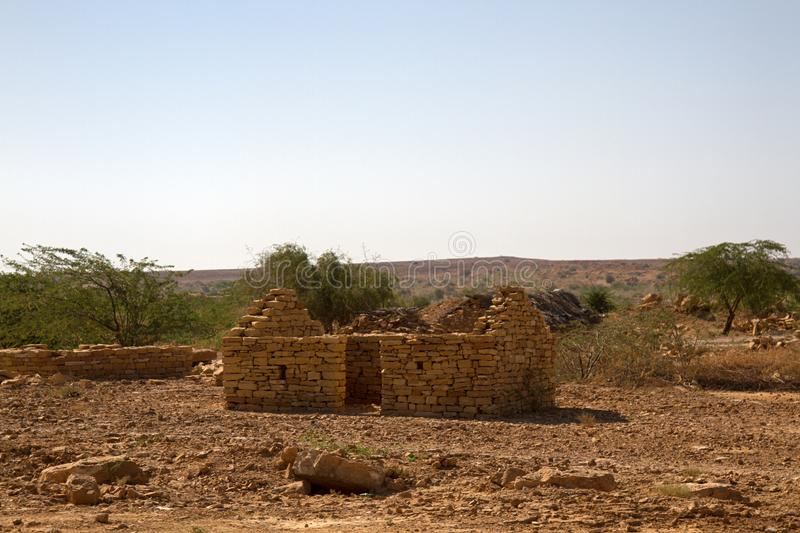Construction of fences and houses made of layered limestone. Without mortar in India, Rajasthan stock images