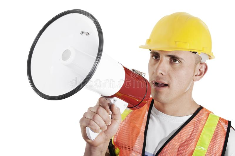 Construction worker. Construction foreman giving orders on bullhorn isolated on white background stock photo