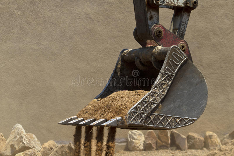 Construction fork lift shovel with dirt royalty free stock images