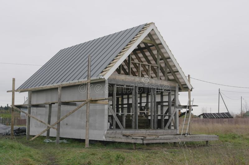 The folded roof frame house stock image