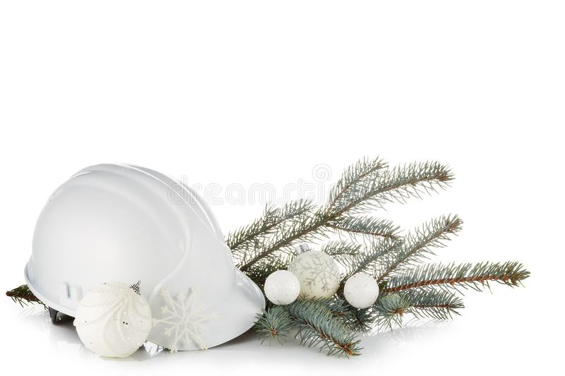 Construction hard hat, fir tree branches and Christmas ornament isolated on a white background. New Year and Christmas. Horizontal royalty free stock photo