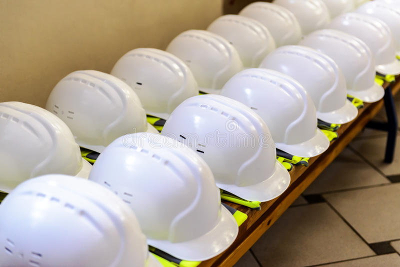 Construction helmets and uniforms royalty free stock photos