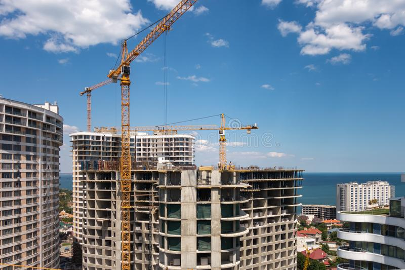 The construction of a high-rise apartment building on the seashore. 2019.07.18. Odessa. Ukraine. Modern, metal, house, urban, architecture, sky, steel, tower stock image