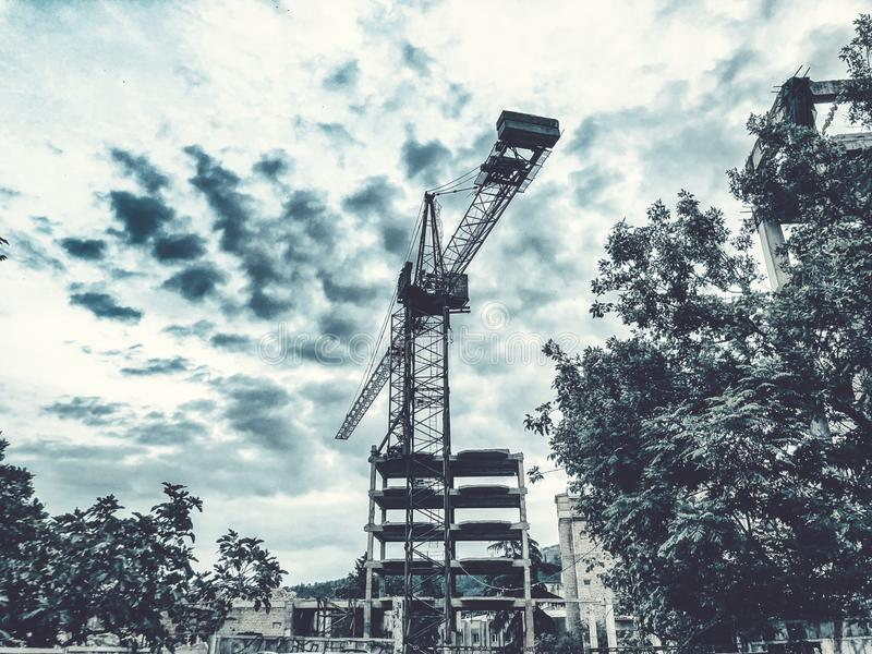 Construction of a high-rise building. Cranes construction hauling cargo. Blue sky.  stock images
