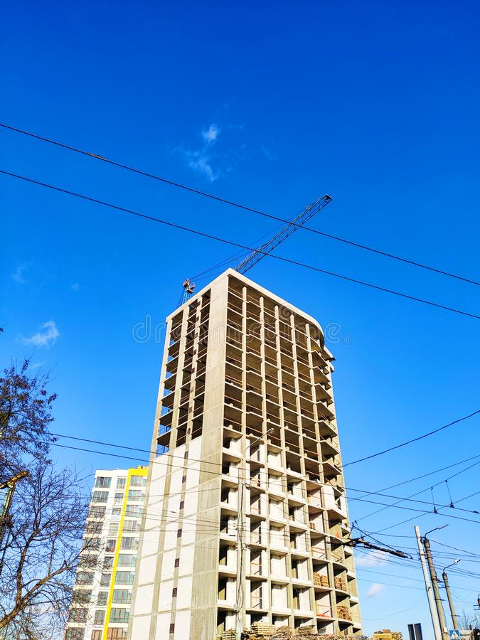 Construction of high-rise buildings in Ivano-Frankivsk. Construction crane. Building against the blue sky.  royalty free stock photos