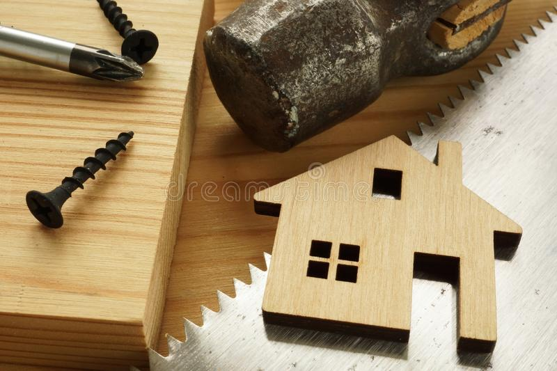 Construction of home and renovation concept. Hand saw and hammer. Construction of home and renovation concept. Hand saw, hammer and screwdriver royalty free stock photo