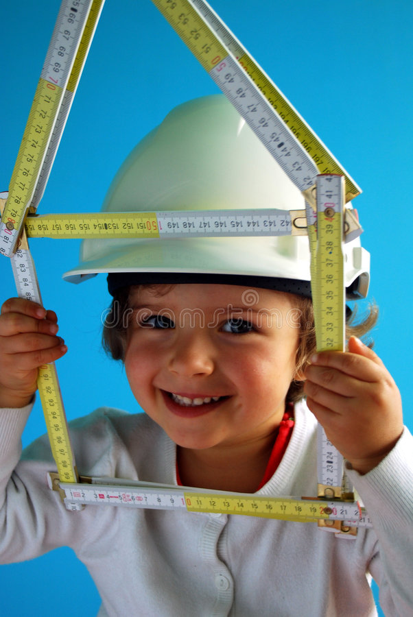 Construction of the house. Beautiful girl is making plans for construction of the house royalty free stock image