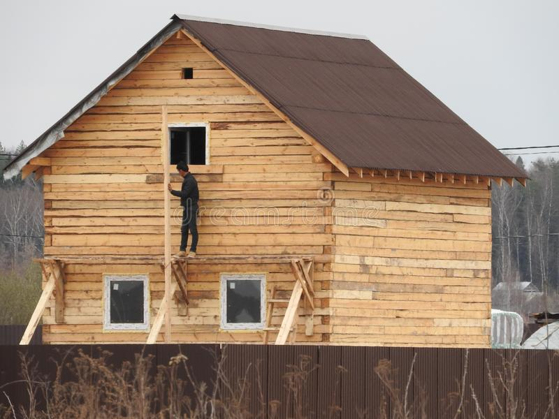 Construction of a house made of laminated veneer lumber. The frame of the house. Cottage made of laminated wood. Erection of the royalty free stock image