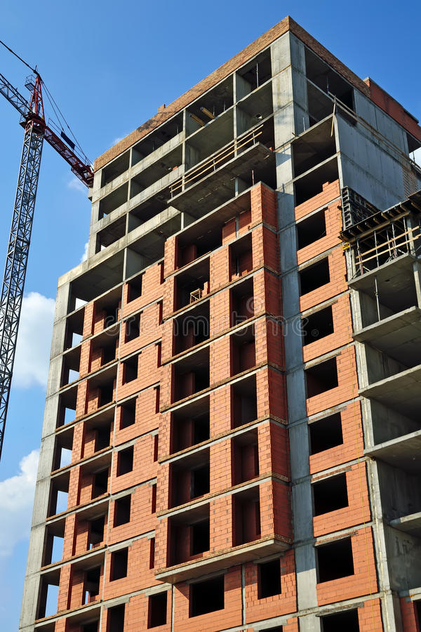 Construction house. And crane against of blue sky royalty free stock photo