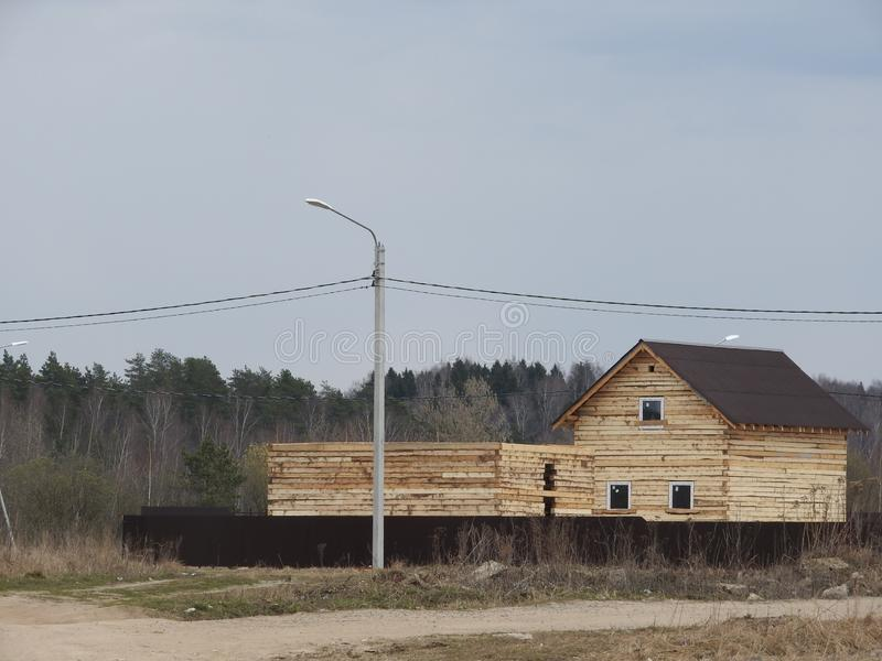Construction of a house made of laminated veneer lumber. The frame of the house. Cottage made of laminated wood. Erection of the stock photography