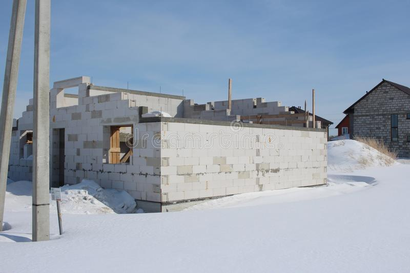 Construction of the house from sibit on the project of a cottage in the winter royalty free stock photos
