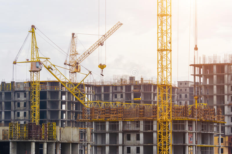 Construction of houses cranes, crash crane crash on the building.  stock image