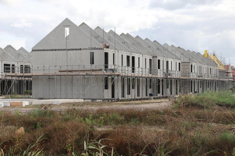 Construction of houses in a new residential district Koningskwartier in Zevenhuizen the Netherlands. royalty free stock photography