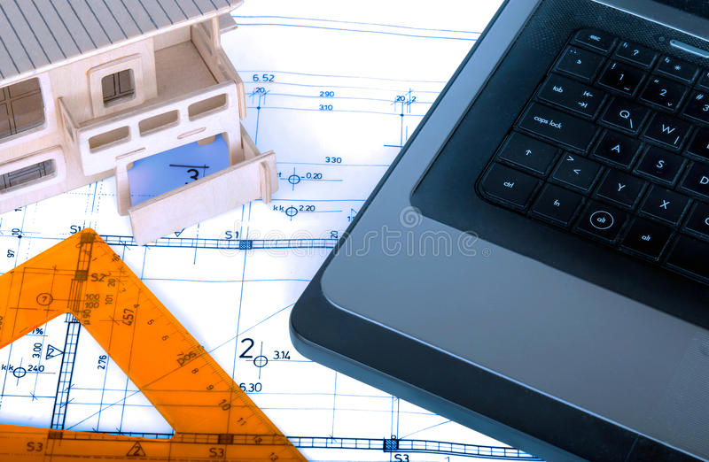 Construction industry Architecture rolls architectural plans project architect blueprints real estate. Concept stock photo