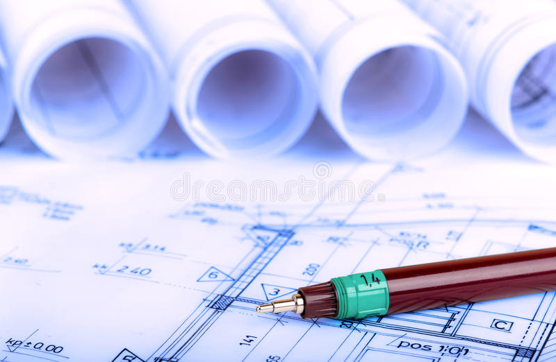 Construction industry Architecture rolls architectural plans project architect blueprints real estate. Concept royalty free stock photo