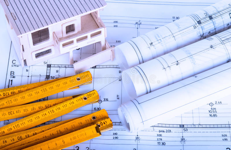 Construction industry Architecture rolls architectural plans project architect blueprints real estate. Concept royalty free stock photography