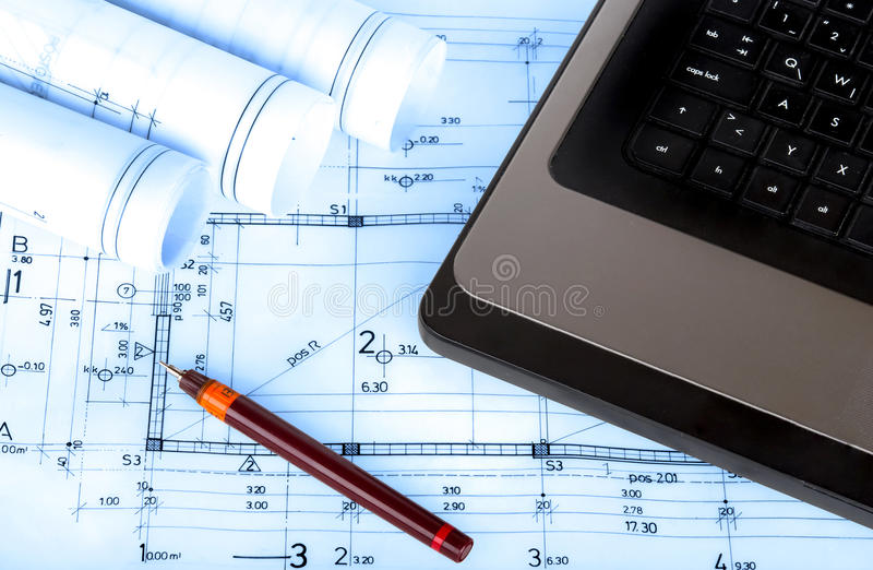 Construction industry Architecture rolls architectural plans project architect blueprints real estate. Concept stock photography