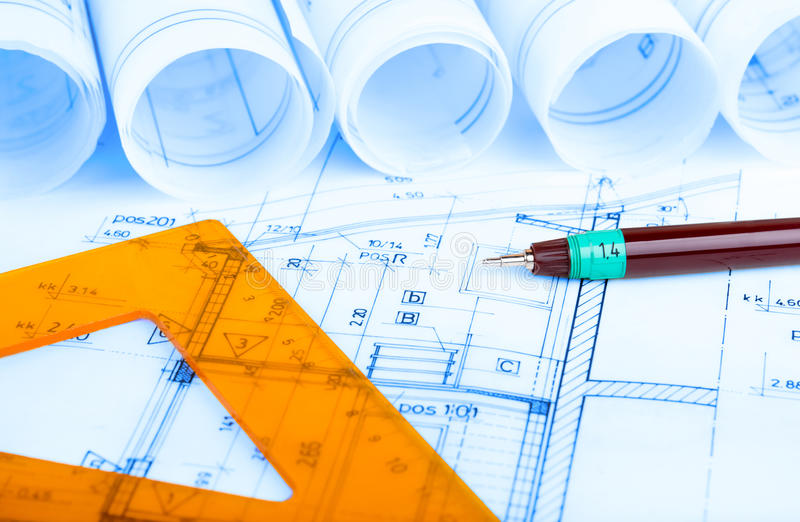 Construction industry Architecture rolls architectural plans project architect blueprints real estate. Concept royalty free stock images
