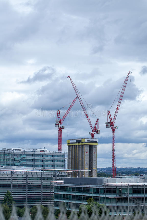 Construction industry over the London skyline. High rise tower b. Uilding being built with cranes stock photos