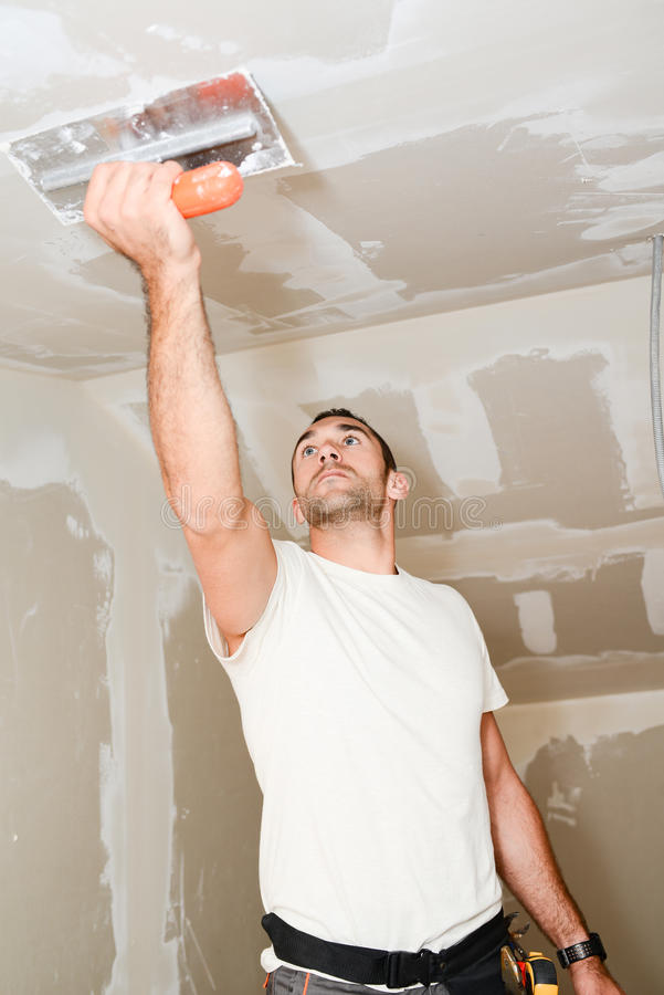 Download Construction Industry Worker With Tools Plastering Walls And Renovating House In Construction Site Stock Photo - Image of business, handyman: 83993376