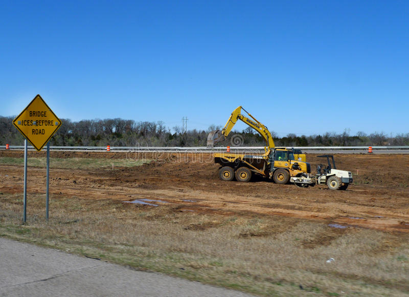 Construction on the interstate system with heavy equipment stock photography