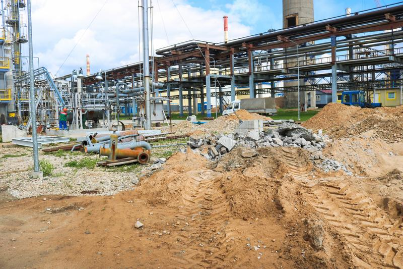 Construction of a large new industrial refinery petrochemical chemical plant with installations and pipelines, power iron and royalty free stock images