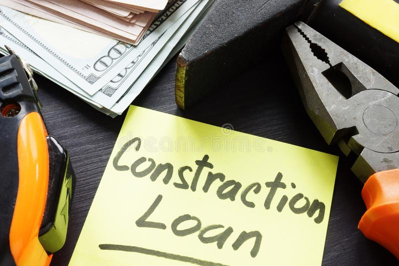 Construction loan concept. Cash and tools. Construction loan concept. Memo stick, cash and tools royalty free stock photos