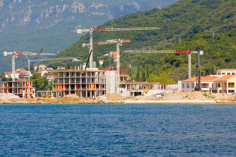 Construction of luxury hotels on the coast. The work of the equipment of the complex buildings royalty free stock photography