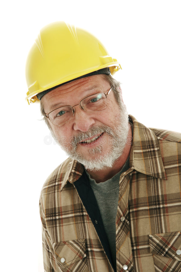 Construction man. Portrait of a senior construction man on white background stock image