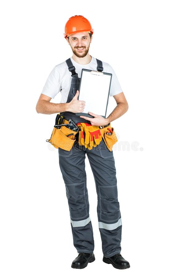 A construction man showing a clean sheet of paper to the clipboard. isolated on white background.  royalty free stock image