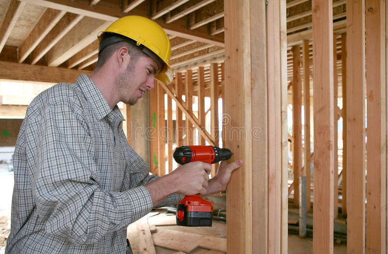 Download Construction Man Using Drill Stock Photo - Image: 2241798