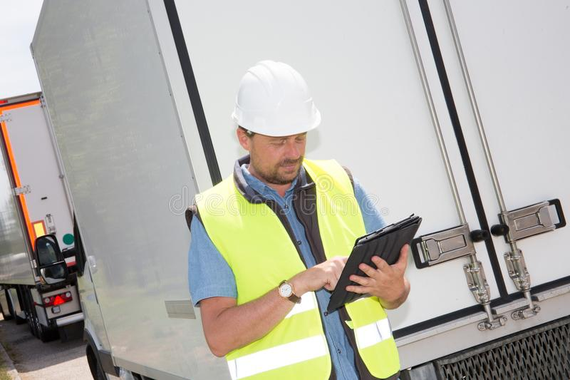 construction man worker operating touch pad device tablet stock photography