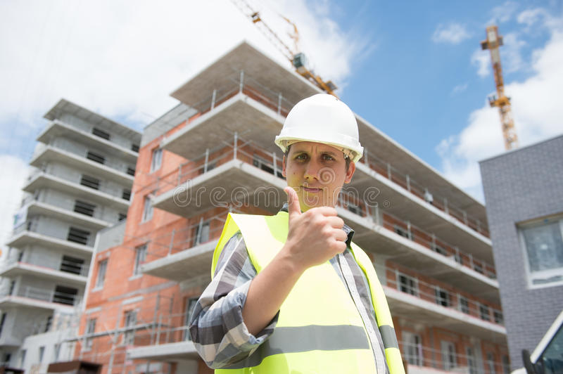 Construction manager checking building project on site royalty free stock photography
