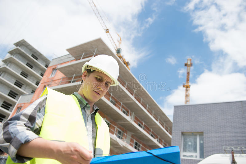 Construction manager checking building project on site royalty free stock photo