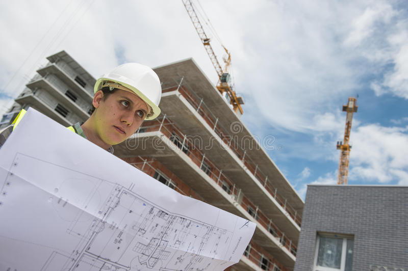 Construction manager checking building project on site. Construction manager checking construction building project on site royalty free stock photos