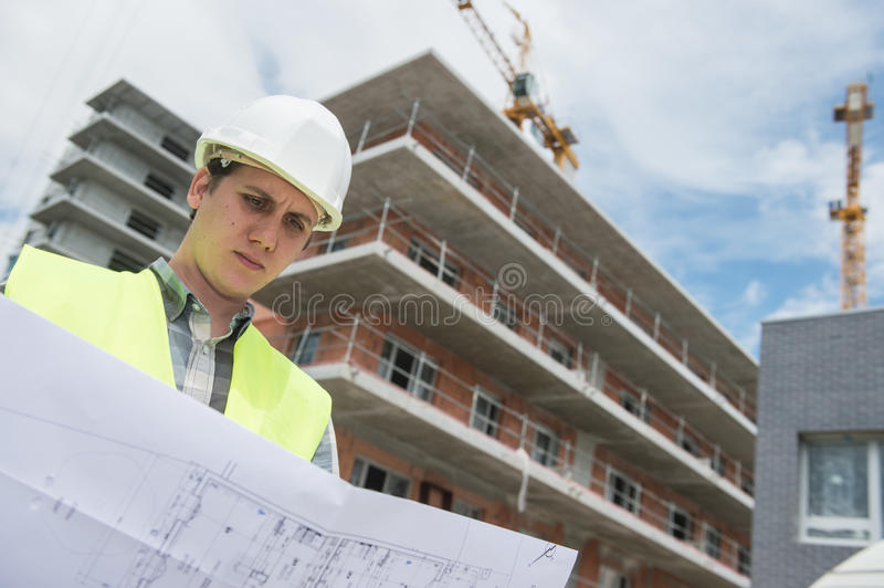 Construction manager checking building project on site. Construction manager checking construction building project on site stock images