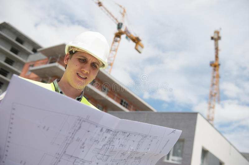 Construction manager checking building project on site. Construction manager checking construction building project on site stock photos