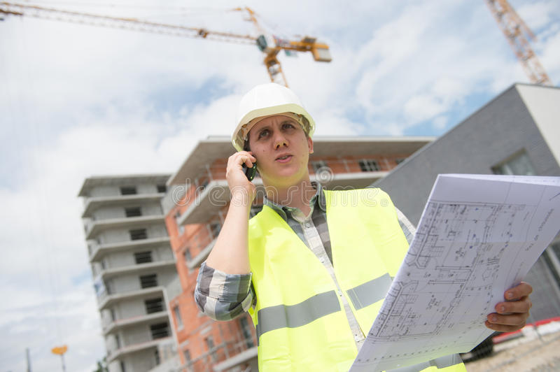 Construction manager checking building project on site. Construction manager checking construction building project on site royalty free stock images