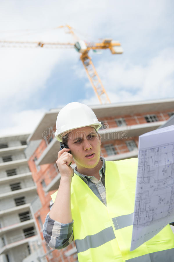 Construction manager checking building project on site. Construction manager checking construction building project on site royalty free stock photography