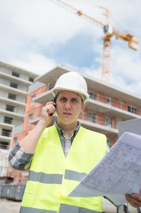 Construction manager checking building project on site. Construction manager checking construction building project on site stock photography
