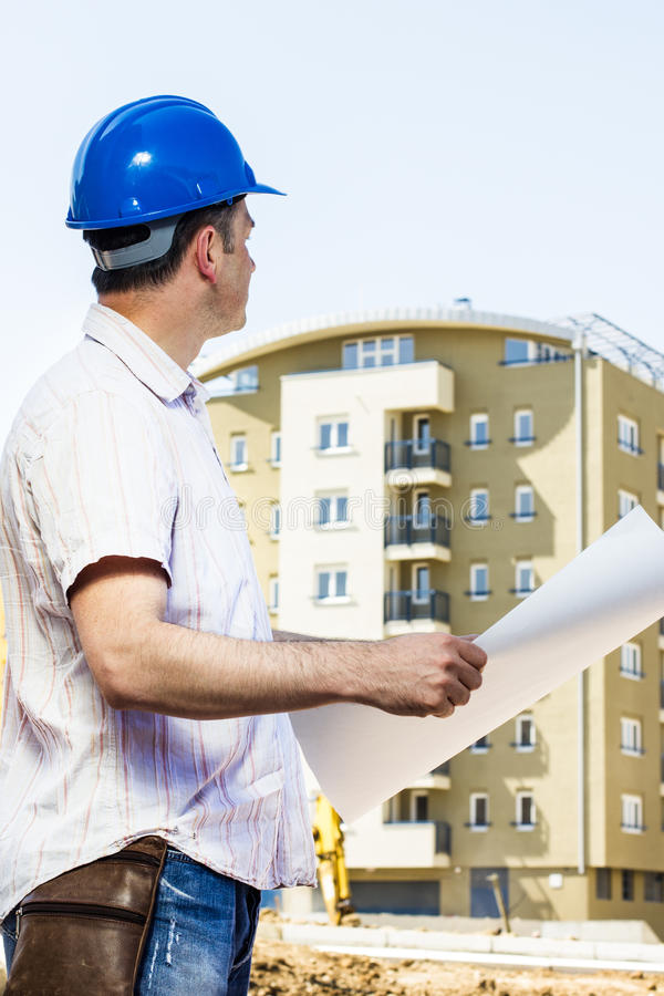 Construction manager holding project stock photos
