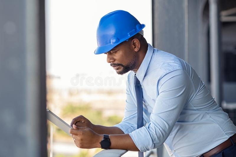 Construction manager using digital tablet royalty free stock photo