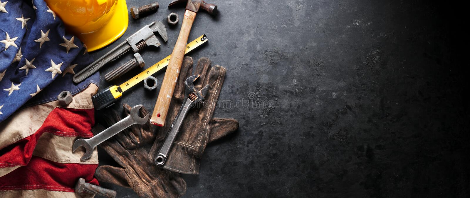 Construction and manufacturing tools with patriotic US, USA, American flag on dark background. Construction and manufacturing tools with patriotic US, USA royalty free stock photos